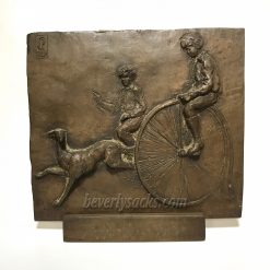 Two Boys Riding Penny-Farthing Bikes Wall Sculpture